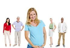 Mullti-ethnic group people pregnant woman Concept Stock Images