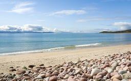 Mulrany Strand, Mayo. Ireland. A lonely atlantic wave breaks on an empty summer beach at Mulrany Strand, County Mayo, on the west coast of Ireland Royalty Free Stock Photo
