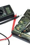 Multímetro e disco duro Foto de Stock