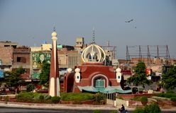 Modern mosque in city center traffic roundabout Multan Pakistan. Multan, Pakistan - September 16, 2016: A uniquely designed modern mosque with a stand alone royalty free stock image