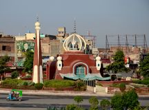 Modern mosque in city center traffic roundabout Multan Pakistan. Multan, Pakistan - September 16, 2016: A uniquely designed modern mosque with a stand alone Stock Photos