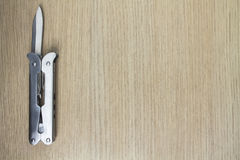 Multi инструмент на деревянной предпосылке 5 Стоковая Фотография