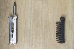 Multi инструмент на деревянной предпосылке 7 Стоковые Фотографии RF
