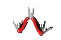 Multi плоскогубцы инструмента с красными ручками Стоковые Изображения RF