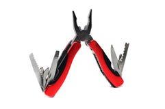 Multi плоскогубцы инструмента с красными ручками Стоковые Фотографии RF