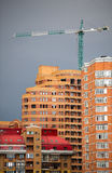 Multi apartments building and crane Royalty Free Stock Image