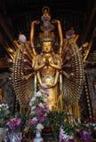Multi armed buddha statue Stock Image