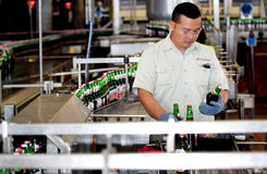 Multi Bintang Indonesia. Production room atmosphere in PT Multi Bintang Indonesia Tbk breweries and bottling facilities in Trawas, Mojokerto, East Java Royalty Free Stock Images