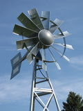 Multi-bladed steel windmill Royalty Free Stock Image