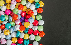 Multi botões coloridos em um fundo preto Imagem de Stock Royalty Free
