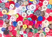 Multi botões coloridos no branco Foto de Stock Royalty Free