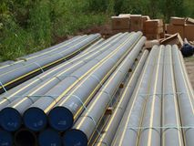 Multi bundles of new presurized gas pipeline on job site. stock photography