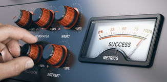 Multi-Channel Marketing, Successful Mass Media Campaign. Hand turning knobs with the texts internet, radio, television and newspaper for a multi-channel Stock Photos