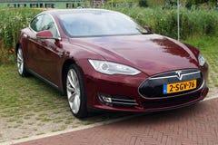 Multi-coat Red Tesla Motors Model S - Front view Stock Photos