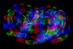 Multi color abstract light painting. LED lights on black background royalty free stock photo