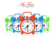 Multi color alarm clocks on white Royalty Free Stock Photography