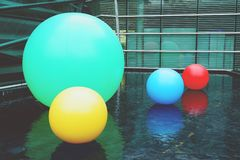 Multi color balls on the water pool. background stock photos