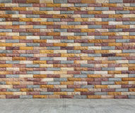 Multi color brick wall and cement floor Stock Photos