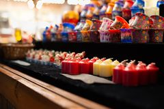 Multi color candles at christmas market stock photography
