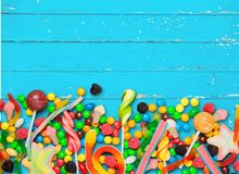 Multi color candy on desk. Yellow multi heap vibrant green dessert Royalty Free Stock Images