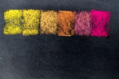 Multi color chalk drawing as striped line on black board. Background stock photography