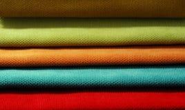 Multi color chenille fabrics. Tissue samples. Multi color chenille tissue samples Fabric texture background Stock Photo