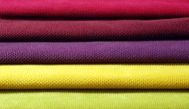 Multi color chenille fabrics. Tissue samples. Multi color chenille tissue samples Fabric texture background Stock Photography