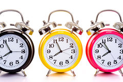 Multi-color clocks on white. A group of multicolor clocks on a white background with copy space stock photography