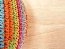 Multi color crochet. On parawood background Stock Image