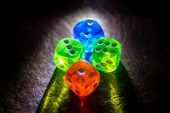 Multi color dice shinning in the dark by soft light royalty free stock photos