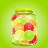 Multi color different citrus slices in bottle jar Royalty Free Stock Image
