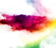 Multi Color dust splash cloud on white background. stock photos
