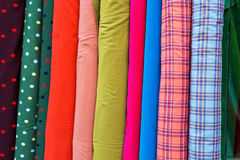 Multi color fabric in a row. Colorful fabric texture background Royalty Free Stock Photography