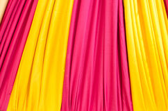 Multi color fabric in a row Royalty Free Stock Photos