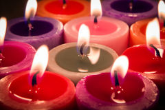 Multi color flame candle Royalty Free Stock Photo