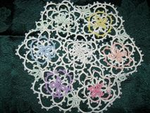 Multi-color Flower Design Tatted Doily stock image