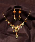 Multi color flower necklace and two earrings in black background Stock Photography