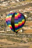 Multi color hot air balloon in flight Royalty Free Stock Photos
