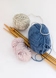 Multi color knitting yarn with needles Stock Image