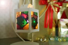 Multi color lantern burner light and christmas and new year gift royalty free stock photo