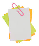 Multi color note with red paper clip Stock Photography
