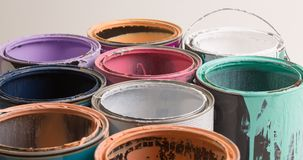 Old paint cans on white. Multi color old paint cans on a white background stock images