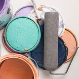 Old paint cans on white. Multi color old paint cans on a white background royalty free stock images