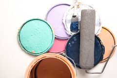 Old paint cans on white. Multi color old paint cans on a white background stock image