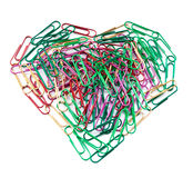 Multi color paper clips arranged in heart shape. Stock Image