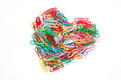 Multi color paper clips arranged in heart shape Royalty Free Stock Image