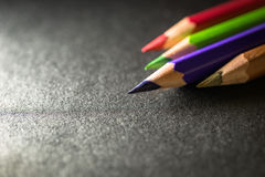 Multi color pencils. In low key, selective focus Stock Images