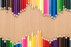 Multi color pencils on wooden table. Color pencils on wooden Stock Images