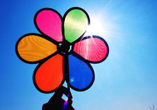 Multi-color pinwheel under sunshine Stock Images