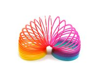 Multi-color plastic spring for playing isolated on white background stock photo